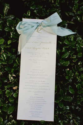 wedding ceremony program gold calligraphy and monogram with light blue ribbon