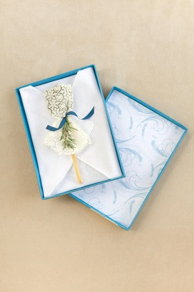 Lace and rosemary wrapped honey stick
