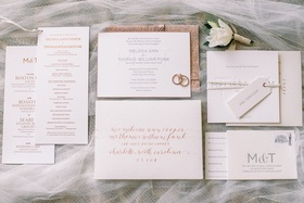 wedding invitation suite with rose gold calligraphy and envelope