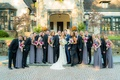Wedding party bridesmaids in lavender grey gowns and groomsmen in tuxedos bow ties maid of honor