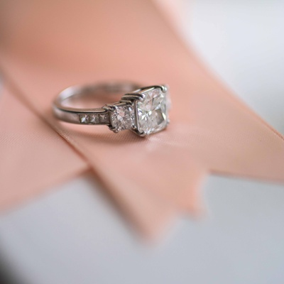 cushion cut 8 prong engagement ring with side stones and accents