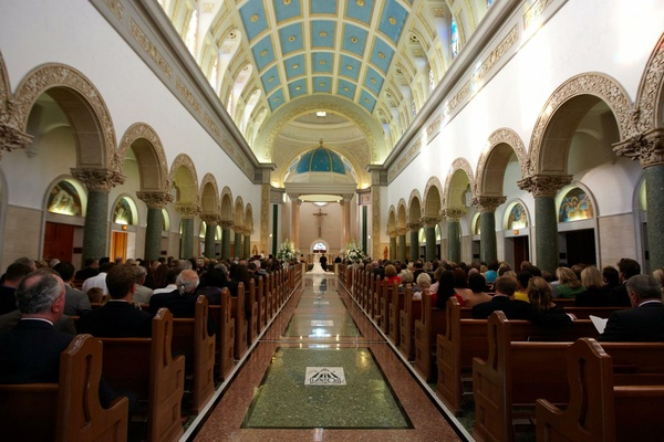 Guests in pews at The Immaculata Parish in San Diego