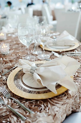 Textured taupe linens with gold charger and linen napkin