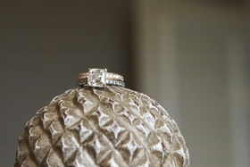 Gold engagement ring with platinum wedding ring