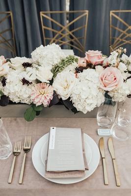 wedding reception place setting gold flatware flower box white hydrangea pink rose dahlia burgundy