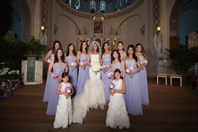 Bride in Vera Wang mermaid dress and bridesmaids in strapless lavender Alvina Valenta gowns