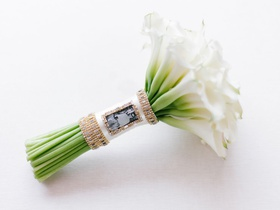 cheryl burke wedding bouquet white calla lily exposed stemss wrapped with crystal and photo of dad