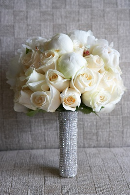 White flowers wrapped in rhinestone ribbon