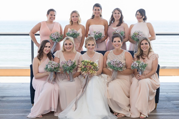 Bridesmaids in mismatched bridesmaid dresses champagne pink blush dresses of choosing barnacle