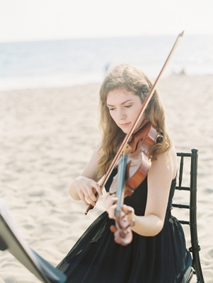 Violin player in black dress on beach at CJ Lana Perry's wedding to Miroslav Rusev Barnyashev