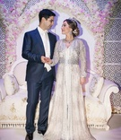 groom navy blue suit bride embellished gown traditional moroccan wedding outfits jewelry bling