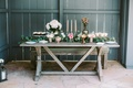 engagement party inspiration, rustic chic desserts, lots of greenery, glowers, candles, cupcakes