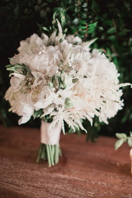 white blooms in bridal bouquet white flowers greenery ribbon