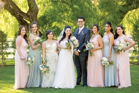 bride with male bridesmaid bridesman and bridesmaids in pink and green dresses pastel tones