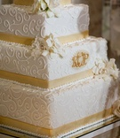 Square four layer cake with lace design