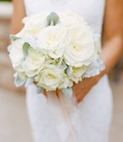 Bride holding dusty miller and white florals