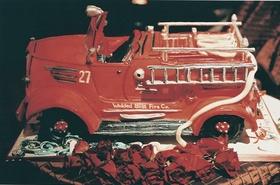 Groom's cake shaped like red firefighter truck
