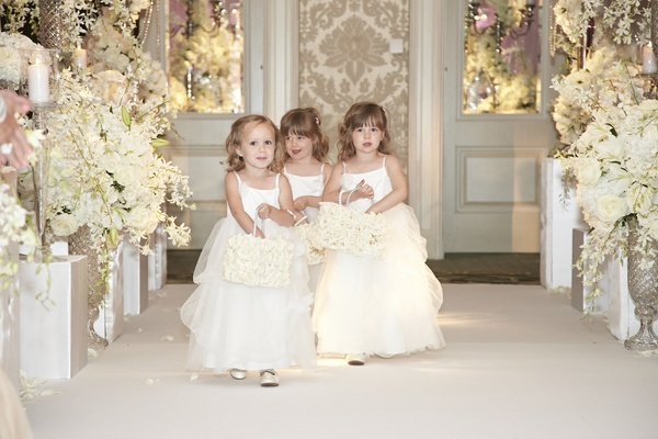 White flower girl dresses and rose-covered baskets