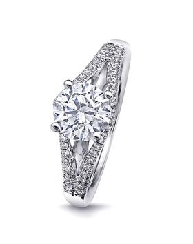 Round-cut diamond ring with split shank of diamonds
