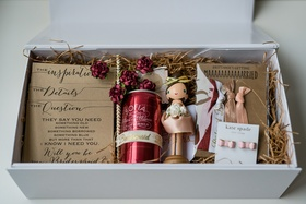 Will You Be My Bridesmaid box gift idea with canned wine, wood bobble head, kate spade earrings