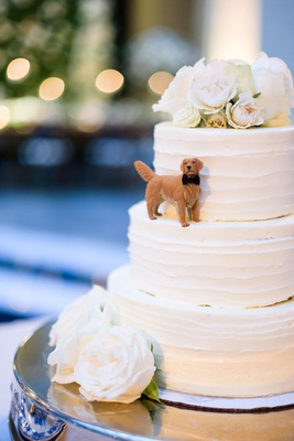 wedding cake three layer white with fresh flower cake topper and figurine of golden retriever