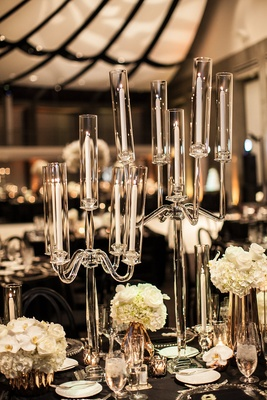 glass candelabra with tapered candles as part of wedding reception decor