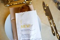 Wedding reception menu printed on bread bag at each guest's place setting