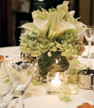 Calla lily and hydrangea filling glass vase
