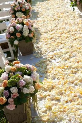 Ivory flower petals on wedding ceremony aisle