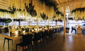 destination wedding decor view of aegean sea in mykonos greece flowers and woven pendants modern