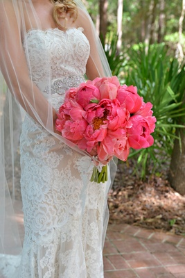 Bride's bouquet of hot pink peonies