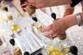 Attendant helps wedding shower guest make perfume
