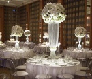 ranunculus blossoms with crystal draped centerpiece bases at Chicago wedding reception