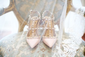 Wedding day heels pink pointed toe pumps studs gold heels on chair with veil over