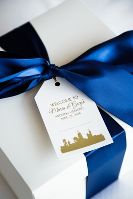 Welcome box gift for guests dark blue ribbon with personalized tag skyline