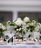 white florals and greenery centerpieces, wide and low centerpiece