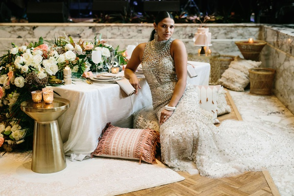 model bride styled shoot high neck beaded wedding dress gold stool ottoman floor pillow morocco