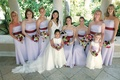 Long strapless bridesmaids dresses in lavender and red sashes
