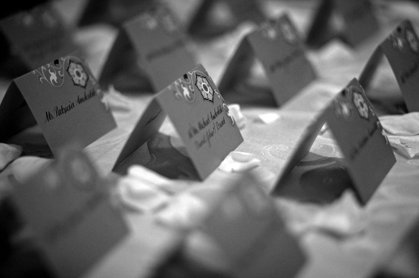 Black and white photo of seating card display