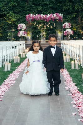 African American flower girl in ruffle dress and ring bearer in tuxedo with bow tie