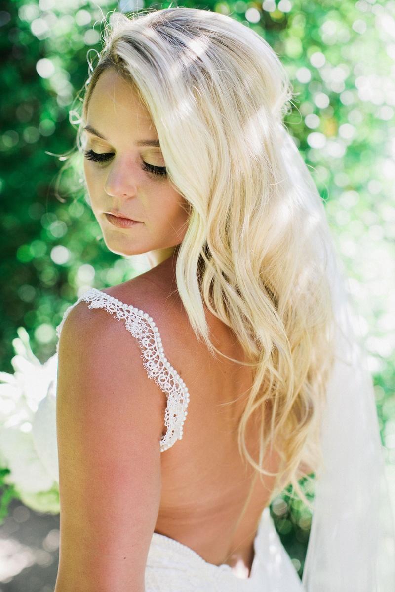bride in galia lahav, false eyelashes, soft waves blonde hair, subtle makeup