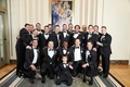 groom and groomsmen in tuxedos with ring bearer at Chicago wedding