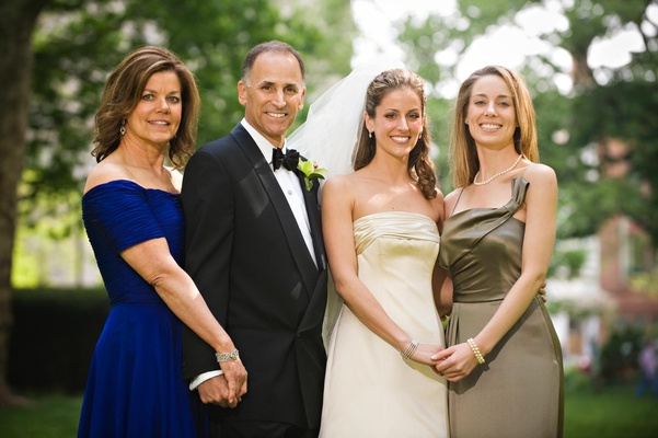 Bride in a Monique Lhuillier gown with family