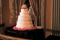 Round wedding cake with pink flower base
