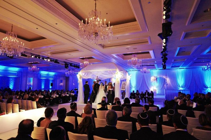 Indoor Jewish wedding ceremony with blue lighting