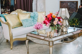 lounge area wedding reception bold floral arrangement mirrors