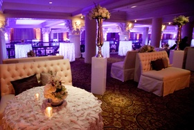 Purple wedding reception lighting in formal lounge area