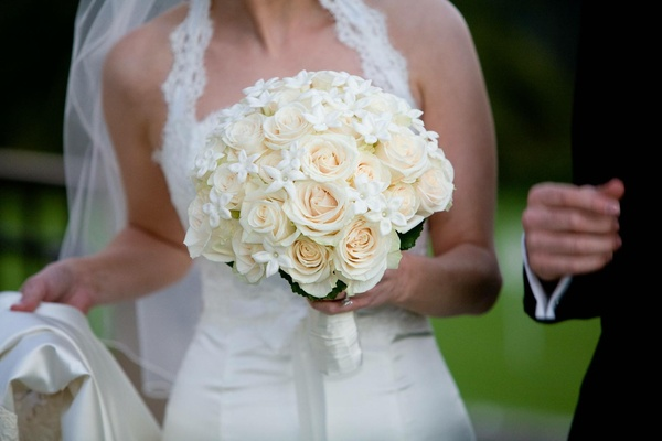 Bridal bouquet featuring roses and stephanotis