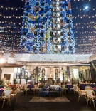 wedding reception hotel figueroa outdoor lounge string lights mural lounge furniture rentals