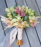 wedding bouquet thistle protea unique bridal bouquet pink light pink ribbon wrapped stems